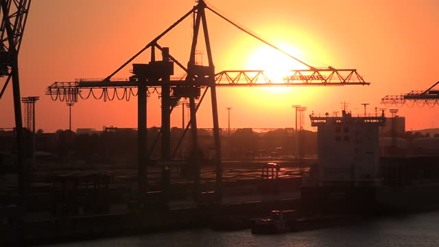 WS T/L View of container trolley at container terminal, river Elbe, harbour of Hamburg, Germany / Hamburg, Germany