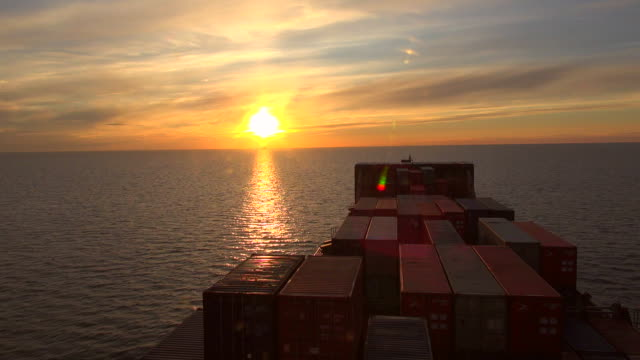 WS POV View of container vessel moving on baltic sea at sunrise, Gdynia, Poland, Europe / Hamburg, Germany