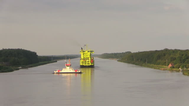 ws pov view of container vessel moving on kiel canal near brunsbuttel, schleswig holstein / hamburg, germany - schleswig holstein stock videos & royalty-free footage