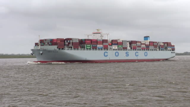 ws ts view of container vessel moving on river elbe near brunsbuttel, schleswig holstein / hamburg, germany - schleswig holstein stock videos & royalty-free footage