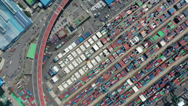 view of containers on gamman dock of busan harbor - container stock-videos und b-roll-filmmaterial