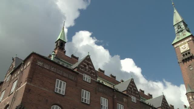 ws pan view of copenhagen town hall / copenhagen, denmark, denmark - rathaus stock-videos und b-roll-filmmaterial