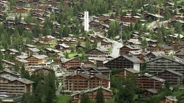 AERIAL View of cottages in ski resort, Verbier, Valais, Switzerland