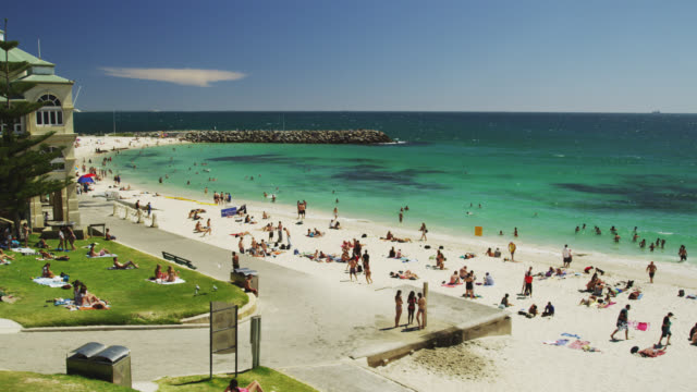 WS View of Cottesloe beach and pavilion with background people / Perth, Western Australia, Australia
