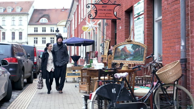 WS View of Couple leaving store, walking together / Potsdam, Brandenburg, Germany