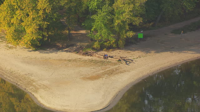 CU AERIAL ZO View of couple sitting on log and confluence of Mississippi River and Minnesota Rivers / Minnesota, United States