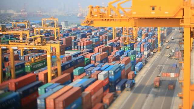 view of crane and cargo container at incheon harbor in incheon - 容器点の映像素材/bロール
