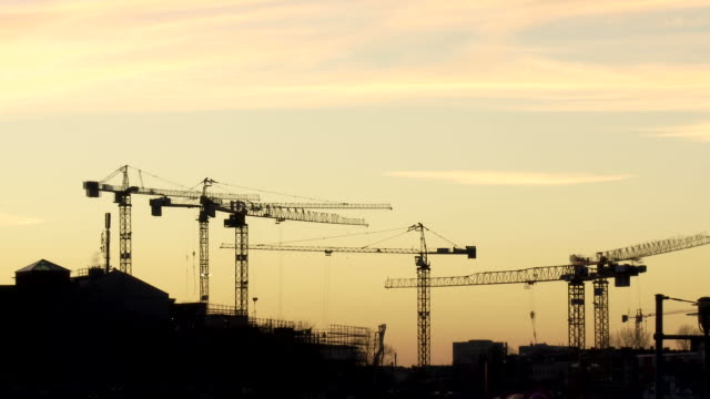 WS T/L View of cranes at construction site at sunset / Berlin, Germany