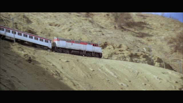 ws ts view of crashing train near tunnel rolling on steep mountain - train crash stock videos and b-roll footage