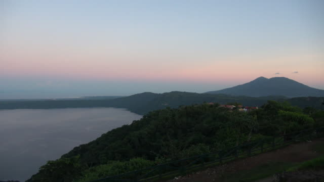 view of crater lake and mountain during sunset - nicaragua stock videos & royalty-free footage