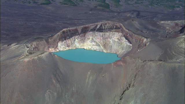 WS POV ZI AERIAL View of Crater Lake in volcanic crater / Kamchatka Krai, Russia