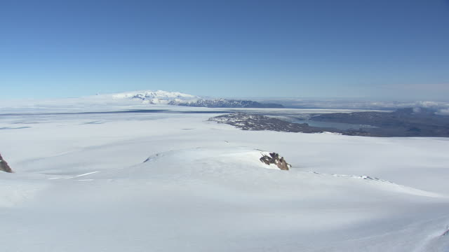 WS AERIAL View of crevasses on snowy mountain at Grimsvotn / Iceland
