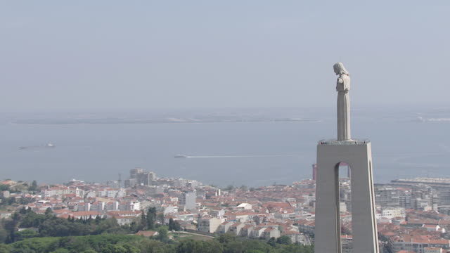 "ws aerial ds zi view of ""cristo rei"" and tagus river / almada, setubal, portugal  - portuguese culture stock videos & royalty-free footage"
