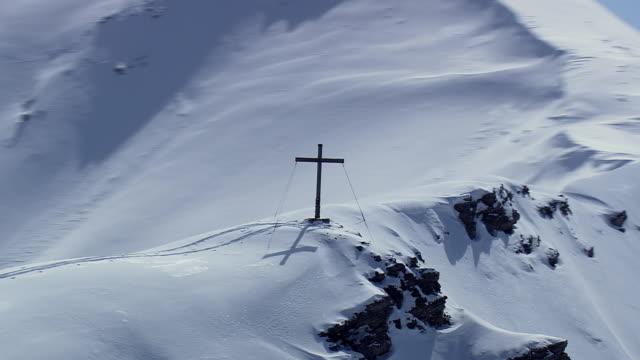 WS AERIAL View of Cross on highest mountain top / Liechtenstein, Switzerland