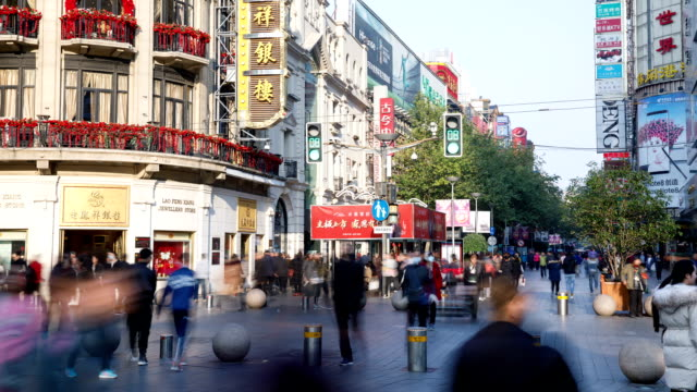 View of crowd and sightseeing bus on Nanjing road at daytime in Shanghai, China