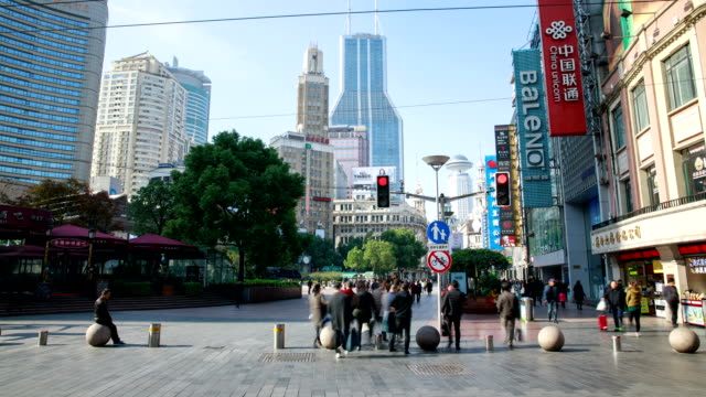 view of crowd and sightseeing bus on nanjing road at daytime in shanghai, china - tour bus stock videos and b-roll footage