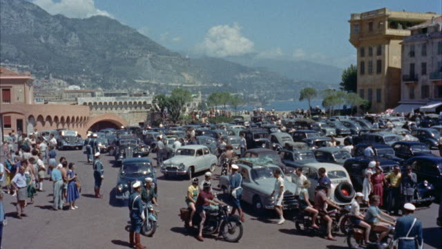 ws view of crowd and traffic outside of palace / monaco - monaco stock videos & royalty-free footage