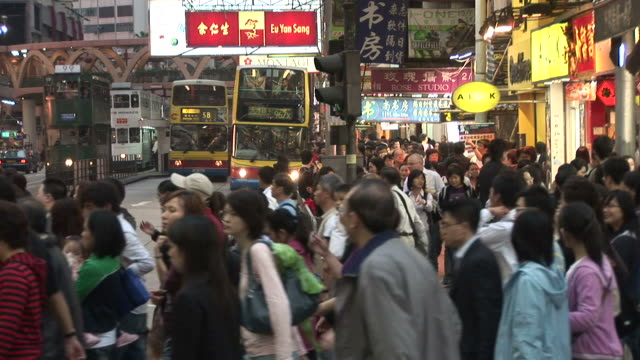 view of crowd crossing the road in hong kong china - zebramuster stock-videos und b-roll-filmmaterial