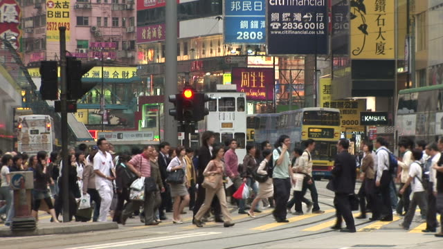 View of crowd crossing the road in Hong Kong China
