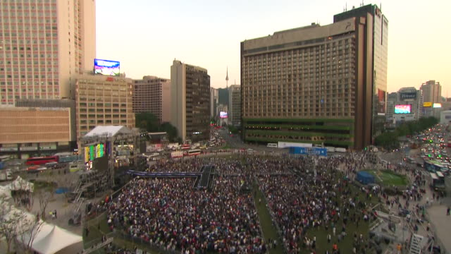 ws td view of crowd is gathering into city hall plaza for concert / seoul, seoul, south korea - concert hall stock videos and b-roll footage