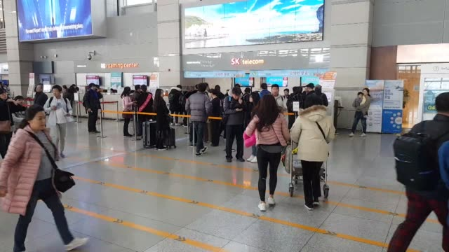 view of crowd tourist at incheon international airport in south korea - korea stock videos & royalty-free footage
