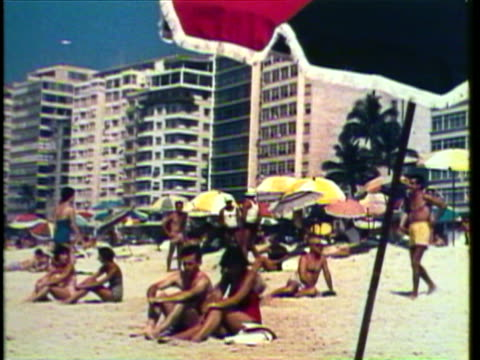 vídeos de stock, filmes e b-roll de 1953 ws view of crowded beaches with people sunbathing / rio de janeiro, brazil / audio - 1950