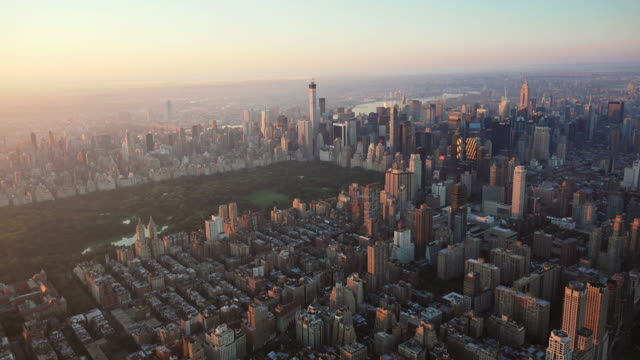 WS AERIAL POV View of crowded cityscape with Central Park / New York City, New York State, United States