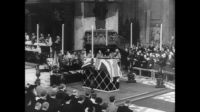 HA view of crowded pews inside St Paul's Cathedral for Churchill's state funeral / Queen Elizabeth standing in front of podium / Churchill's coffin...