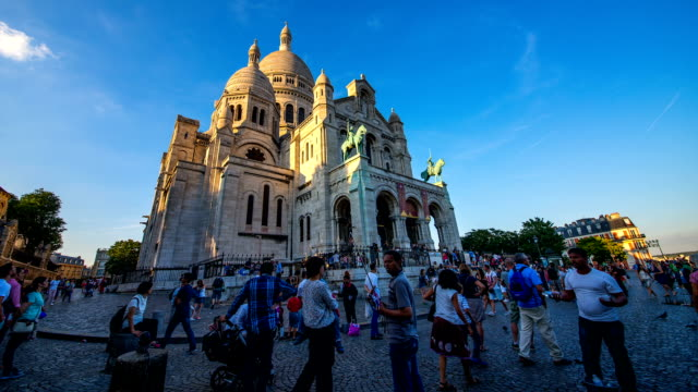 View of crowded tourists and Basilique Du Sacre Coeur of Montmartre at Paris