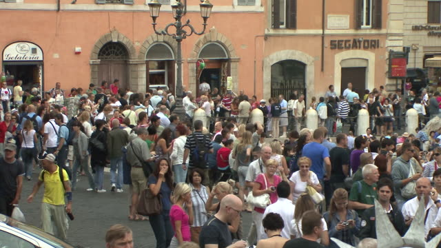 ws view of crowds at the trevi fountain / rome, italy  - travel destinations video stock e b–roll