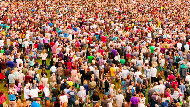 ms t/l view of crowds of people attending music festival at day to night / united kingdom - large group of people stock videos & royalty-free footage