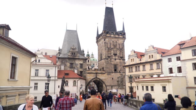 view of crowds of traveller on charles bridge in prague during raining day, czech republic. - traditionally czech stock videos & royalty-free footage