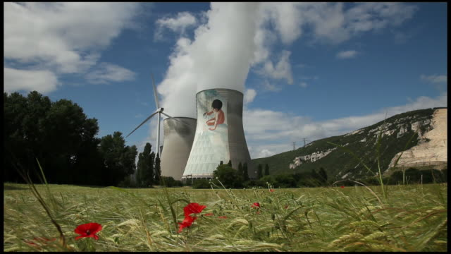 view of cruas nuclear power station from corn field, france, ardeche - french culture stock videos & royalty-free footage