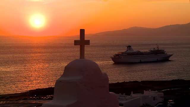 ws view of cruise ship at sunset / mykonos, cyclades, greece - mykonos stock videos and b-roll footage