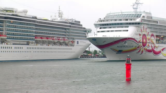 ws view of cruise ship in front of red buoy at warnemunde harbor near rostock / warnemunde, mecklenburg vorpommern, germany - cruise stock videos & royalty-free footage