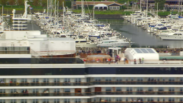 ws aerial zo view of cruise ship with sailboat moving in water in front of elliott bay marina / seattle, washington, united states - elliott bay stock videos & royalty-free footage