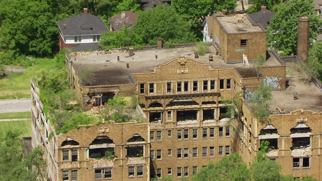 MS AERIAL POV ZO View of crumbling and dilapidated apartment buildings / Lake County, Gary, Indiana, United States