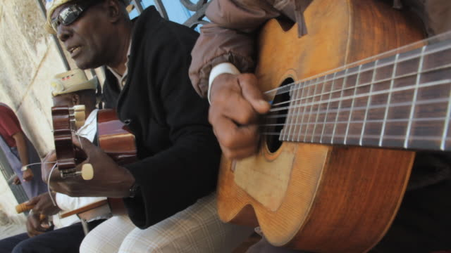 cu view of cuban musician playing guitar / havana, cuba - cuba stock videos & royalty-free footage