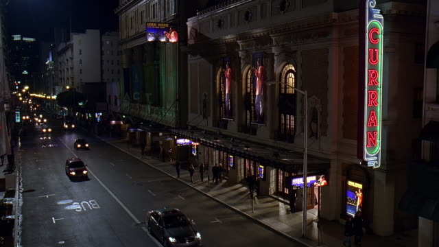 ws cs view of curran theatre with traffic on road at night / san francisco, california, usa  - großbuchstabe stock-videos und b-roll-filmmaterial