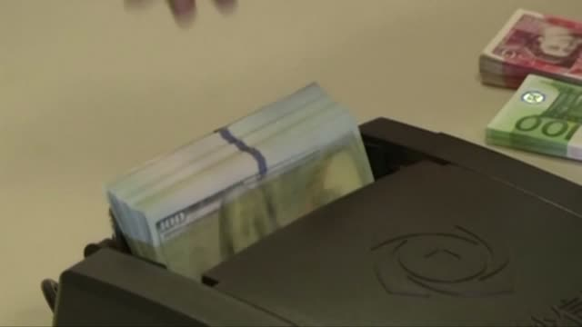 view of currency-counting machine checking a bundle of us dollars in south korea - bank stock videos & royalty-free footage