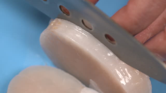 view of cutting the adductor muscle of shellfish with knife - clam seafood stock videos and b-roll footage