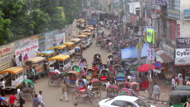 ws ha view of cycle rickshaws buses and pedestrians on busy street / dhaka, bangladesh - dhaka stock videos & royalty-free footage