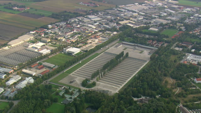 ws aerial ts view of dachau concentration camp and houses / germany - konzentrationslager stock-videos und b-roll-filmmaterial