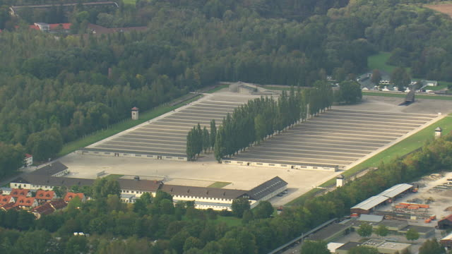 ws aerial view of dachau concentration camp and houses / germany - konzentrationslager stock-videos und b-roll-filmmaterial