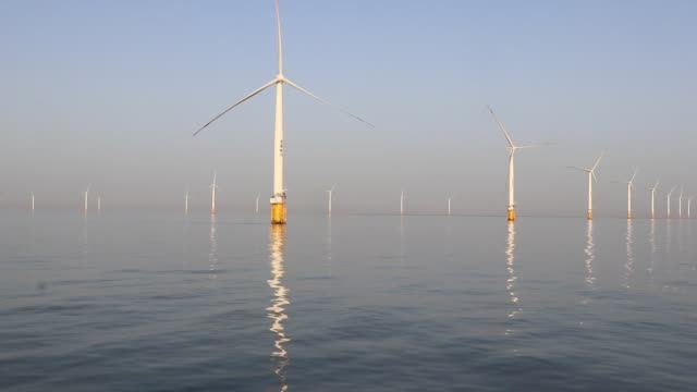 a view of dafeng wind turbine site in the sea on november 11 2019 in yancheng jiangsu province of china - windmill stock videos & royalty-free footage