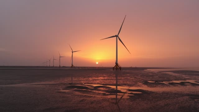 a view of dafeng wind turbine site in the sea on november 11 2019 in yancheng jiangsu province of china - wind turbine stock videos & royalty-free footage