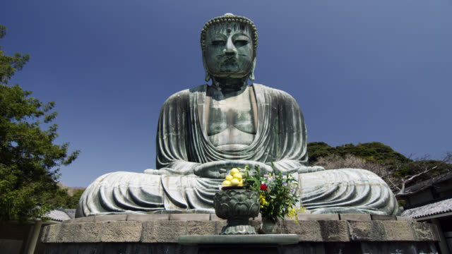 ws view of daibutsu-great buddha of kotokuin temple / kamakura, kanagawa, japan - buddha stock videos & royalty-free footage