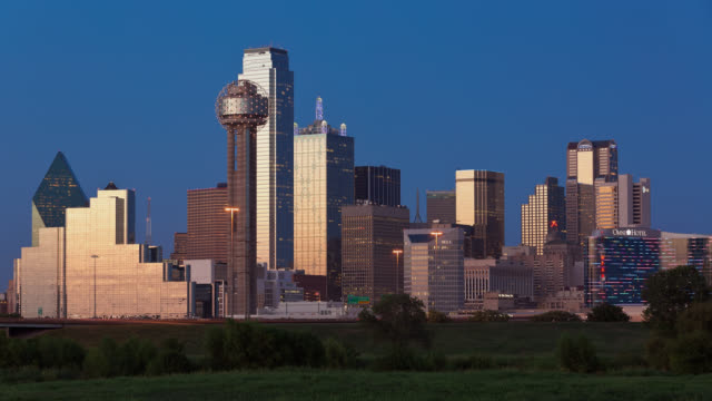 T/L View of Dallas city skyline and Reunion Tower at dusk / Dallas, Texas, USA