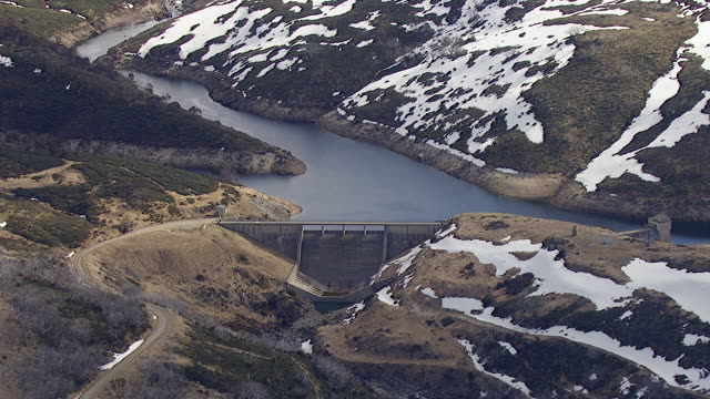 WS AERIAL View of dam at snow covered mountain / Kings Cliff, New South Wales, Australia