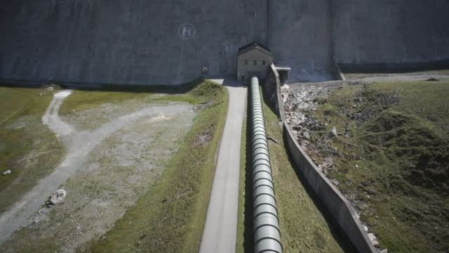 WS POV View of dam with mountain pass in Austria